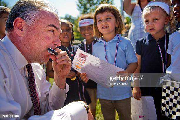 Sen Tim Kaine DVa plays 'You Are My Sunshine' on the harmonica during a MomsRisingorg and National Womens Law Center event on the West Front of the...