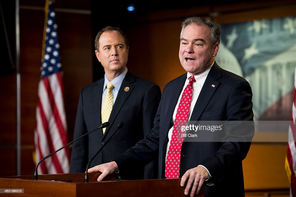 Sen. Tim Kaine, D-Va., right, and House Intelligence ranking member Rep. Adam Schiff, D-Calif., hold a news conference to discuss military force against ISIL, including 'advocating for a congressional debate and vote on a new authorization' in the Capitol on Wednesday, Feb. 11, 2015.
