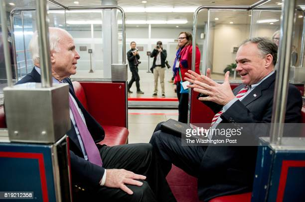 Sen Tim Kaine right speaks with Sen John McCain left on the Senate subway on Capitol Hill on January 8 2015 in Washington DC