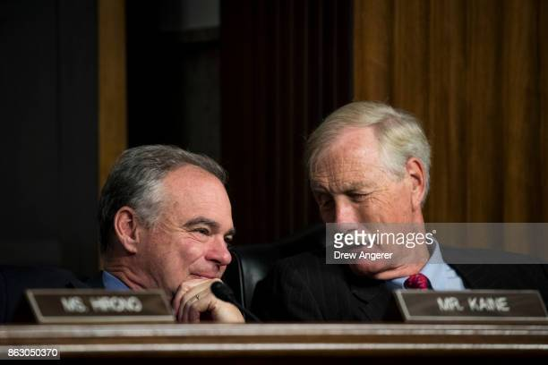 Sen Tim Kaine talks with Sen Angus King during a Senate Armed Services Committee hearing concerning the roles and responsibilities for defending the...