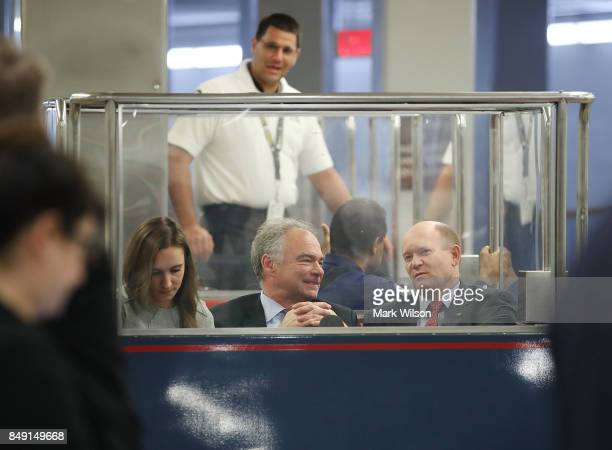 Sen Tim Kaine talks with Sen Christopher Coons while riding in the Senate Subway before the Senate takes up the National Defense Authorization Act...