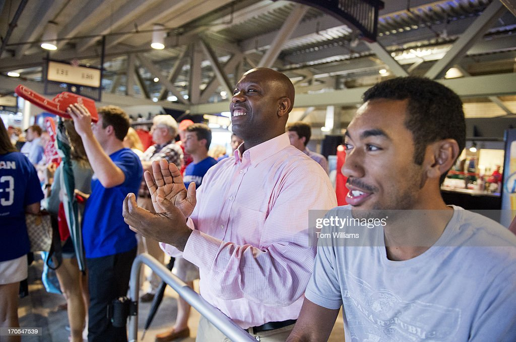 Sen. Tim Scott, R-S.C., applauds during the Congressional Baseball game where the Democrats beat the Republicans 22-0 at Nationals Park.