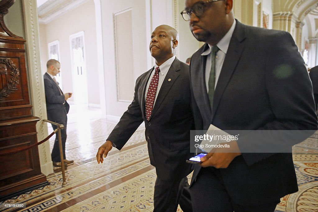 Sen. <a gi-track='captionPersonalityLinkClicked' href=/galleries/search?phrase=Tim+Scott+-+Pol%C3%ADtico&family=editorial&specificpeople=12898323 ng-click='$event.stopPropagation()'>Tim Scott</a> (R-SC) told reporters he supports taking down the Confederate flag from the front of his state's capitol building after the weekly Republican Senate policy luncheon at the U.S. Capitol June 23, 2015 in Washington, DC. The Senate passed an important procedural vote on the Trans Pacific Partnership bill, which would grant President Barack Obama enhanced negotiating powers to complete a major trade accord, clearing the way for final passage as early as Wednesday.