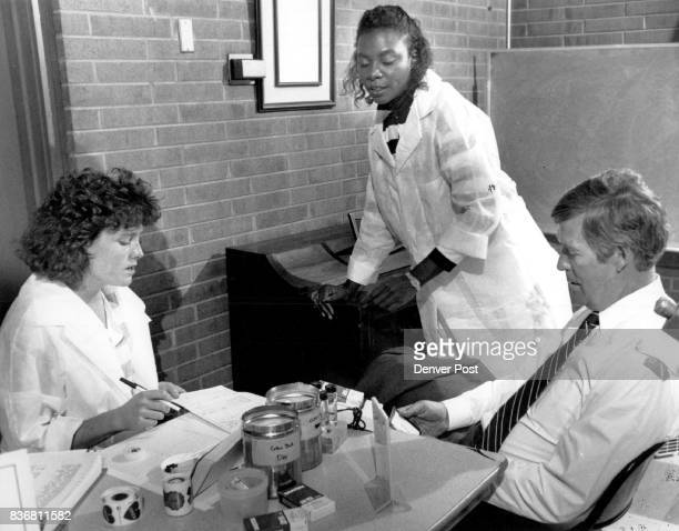 Sen Tim Wirth sits incredulously at the American Red Cross 170 Steels St after he was turned down for giving blood by Belle Bonfils Mobile Blood Band...