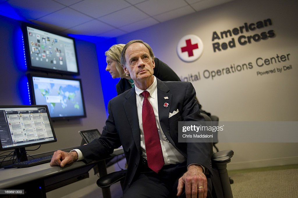Sen. Tom Carper, D-Del., takes a tour of the Red Cross headquarters' Digital Operations Center in Washington, D.C. It is the hub for all social media news about disasters.