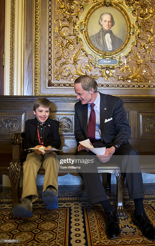 Sen. Tom Carper, D-Del., talks with Cole Hamstead, 7, of New Castle, Del., in the Senate Reception Room while Cole was visiting members of Congress with the National Hemophilia Foundation. Cole suffers from hemophilia and was educating members about the disease and the financial burden of treatment.
