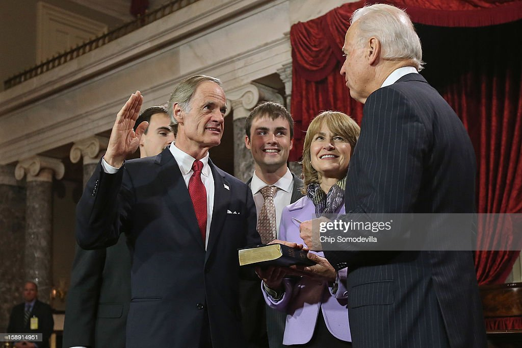 U.S. Sen. Tom Carper (D-DE) participates in a reenacted swearing-in with his wife Martha Ann Stacy and U.S. Vice President Joe Biden in the Old Senate Chamber at the U.S. Capitol January 3, 2013 in Washington, DC. Biden swore in the newly-elected and re-elected senators earlier in the day on the floor of the current Senate chamber.