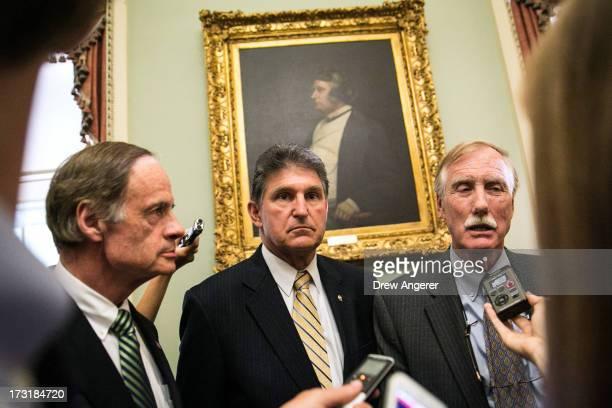 Sen Tom Carper Sen Joe Manchin and Sen Angus King speak to reporters after meeting with fellow Democratic Senators on Capitol Hill July 9 2013 in...