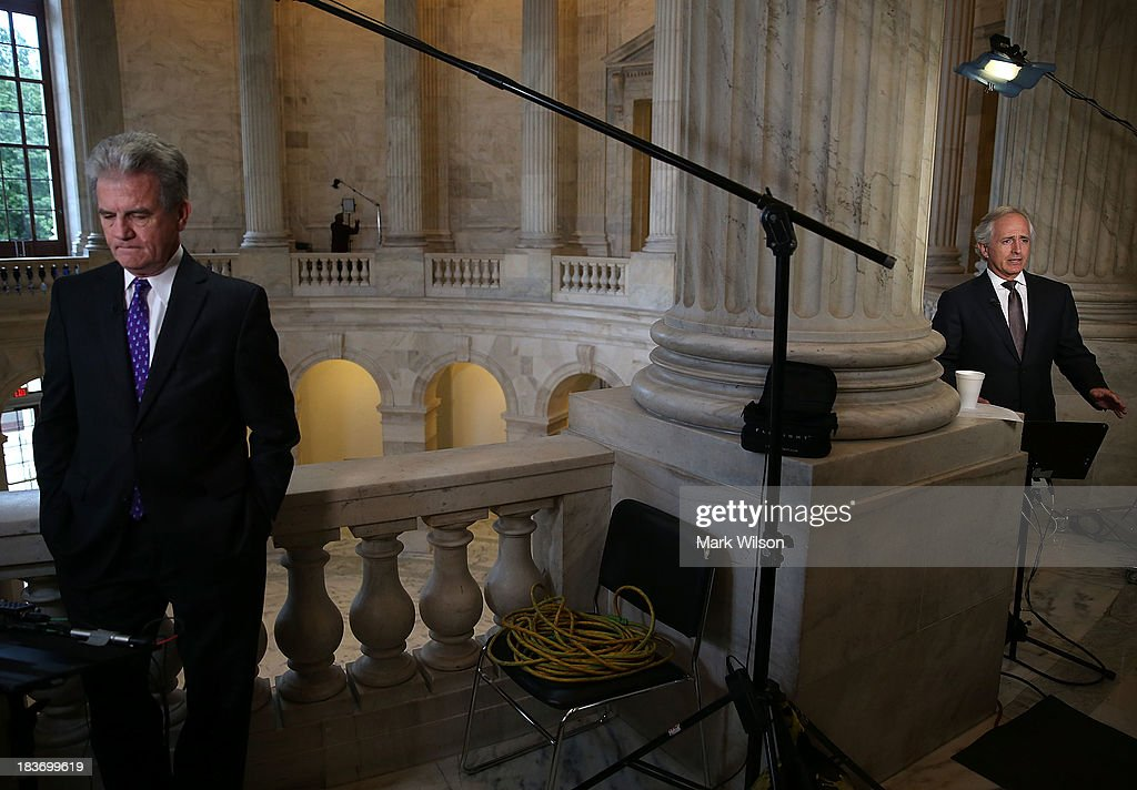 Sen. Tom Coburn (R-OK) (L) and Sen. Bob Corker (R-TN) do television interviews at the U.S. Capitol, October 9, 2013 in Washington, DC. The U.S. government shutdown is entering its ninth day as the U.S. Senate and House of Representatives remain gridlocked on funding the federal government.