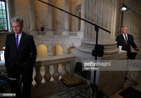 Sen Tom Coburn and Sen Bob Corker do television interviews at the US Capitol October 9 2013 in Washington DC The US government shutdown is entering...