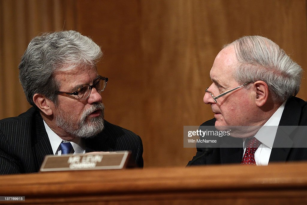 Sen Tom Coburn and Sen Carl Levin confer before a hearing of the Senate Homeland Security and Governmental Affairs Committee January 26 2012 in...