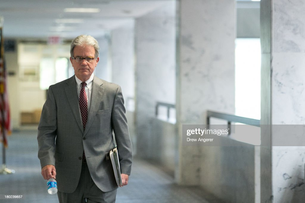 U.S. Sen. <a gi-track='captionPersonalityLinkClicked' href=/galleries/search?phrase=Tom+Coburn&family=editorial&specificpeople=568690 ng-click='$event.stopPropagation()'>Tom Coburn</a> (R-IA) arrives for a Senate Intelligence Committee closed hearing, on Capitol Hill, September 10, 2013 in Washington, DC. President Barack Obama will address the nation about Syria on Tuesday evening.