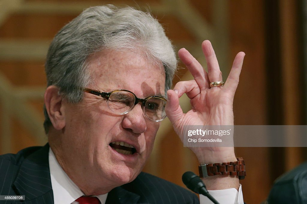 U.S. Sen. <a gi-track='captionPersonalityLinkClicked' href=/galleries/search?phrase=Tom+Coburn&family=editorial&specificpeople=568690 ng-click='$event.stopPropagation()'>Tom Coburn</a> (R-OK) forms a circle with his fingers while asking witnesses about 30mm calibre ammunition that has been given to local law enforcement departments by the federal government during a Senate Homeland Security and Governmental Affairs Committee hearing about the oversight of military equipment given to state and local police at the Dirksen Senate Office Building on Capitol Hill September 9, 2014 in Washington, DC. In the wake of the Ferguson, MO, police response to peaceful protests, senators on the committee were critical of the federal grant programs that allow local and state law enforcement agencies to buy armored vehicles, assult rifles, body armor and other military equipment.