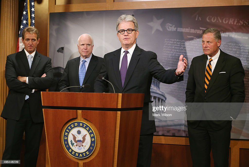 Sen. Tom Coburn (R-OK) speaks about veterans while flanked by Sen. Jeff Flake (R-AZ) (L), Sen. John McCain (R-AZ)(2nd L) and Sen. Richard Burr (R-NC)(R), during a news conference on Capitol Hill, June 3, 2014 in Washington, DC. The four Senators introduced The Veterans Choice Act, which addresses issues raised by the scandal at the U.S. Department of Veterans Affairs, and provides veterans with greater flexibility and choice in health care providers and increasing accountability and transparency at the Veterans Affairs administration.