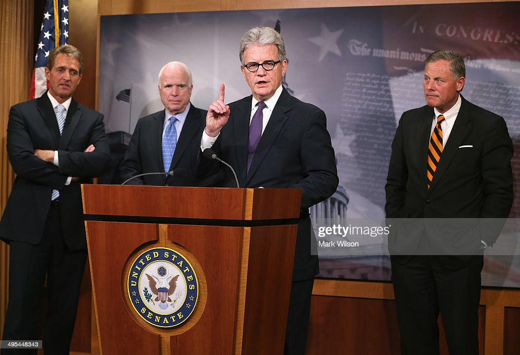 Sen. Tom Coburn (R-OK) speaks about veterans while flanked by Sen. Jeff Flake (R-AZ) (L), Sen. John McCain (R-AZ)(2ndL) and Sen. Richard Burr (R-NC)(R), during a news conference on Capitol Hill, June 3, 2014 in Washington, DC. The four Senators introduced The Veterans Choice Act, which addresses issues raised by the scandal at the U.S. Department of Veterans Affairs, and provides veterans with greater flexibility and choice in health care providers and increasing accountability and transparency at the Veterans Affairs administration.