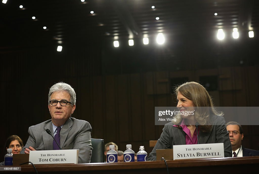 U.S. Sen. <a gi-track='captionPersonalityLinkClicked' href=/galleries/search?phrase=Tom+Coburn&family=editorial&specificpeople=568690 ng-click='$event.stopPropagation()'>Tom Coburn</a> (R-OK) speaks as Director of the White House Office of Management and Budget <a gi-track='captionPersonalityLinkClicked' href=/galleries/search?phrase=Sylvia+Mathews+Burwell&family=editorial&specificpeople=7165922 ng-click='$event.stopPropagation()'>Sylvia Mathews Burwell</a> testifies during her confirmation hearing before the Senate Finance Committee May 14, 2014 on Capitol Hill in Washington, DC. If confirmed, Burwell will succeed Kathleen Sebelius to become the next secretary of Health and Human Services.