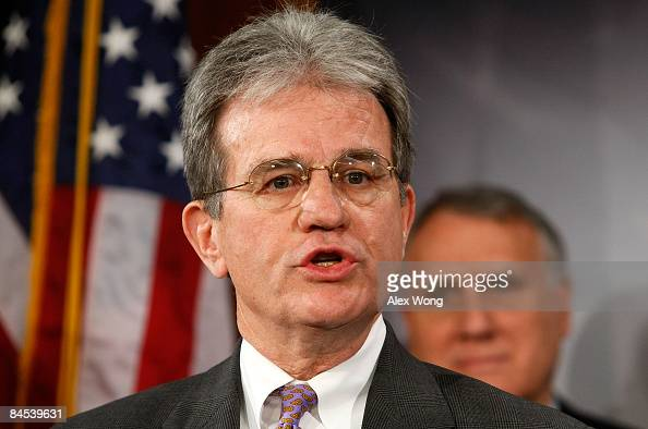 S Sen Tom Coburn speaks as Senate Minority Whip Jon Kyl listens during a news conference on the economic stimulus package on Capitol Hill January 29...