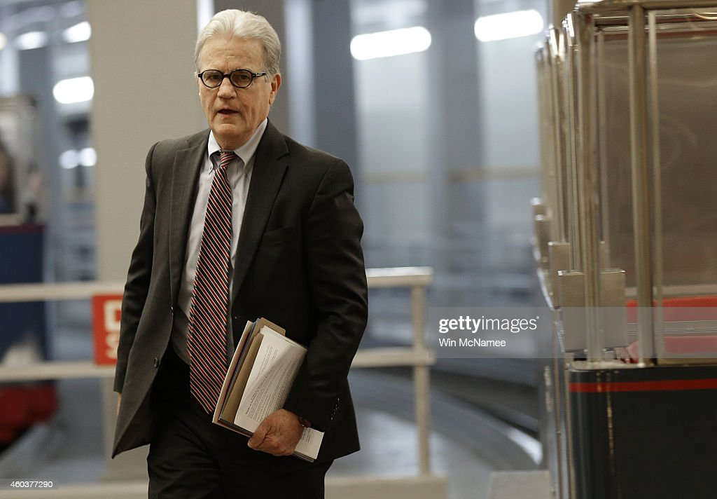 Sen. <a gi-track='captionPersonalityLinkClicked' href=/galleries/search?phrase=Tom+Coburn&family=editorial&specificpeople=568690 ng-click='$event.stopPropagation()'>Tom Coburn</a> (R-OK) walks to the Senate floor for a series of votes December 12, 2014 in Washington, DC. The U.S. Senate is expected to pass an omnibus funding bill to fund the federal government later today or tomorrow.