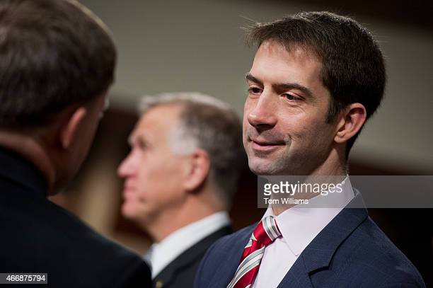 Sen Tom Cotton RArk right talks with Navy Adm Michael Rogers before a Senate Armed Services Committee hearing in Dirksen Building titled 'US...