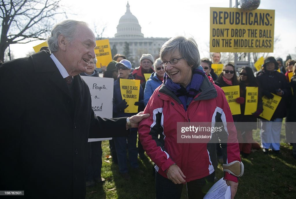 "Sen. Tom Harkin, D-Iowa, greets Sister Simone Campbell, who led the ""Nuns on the Bus"" tour, at 'The Action' rally urging the Republicans in Congress 'not to drop the ball on the middle class, and give massive tax breaks to the richest Americans as the New Year and the impending $2,000 tax hike on middle-class families approaches.'"