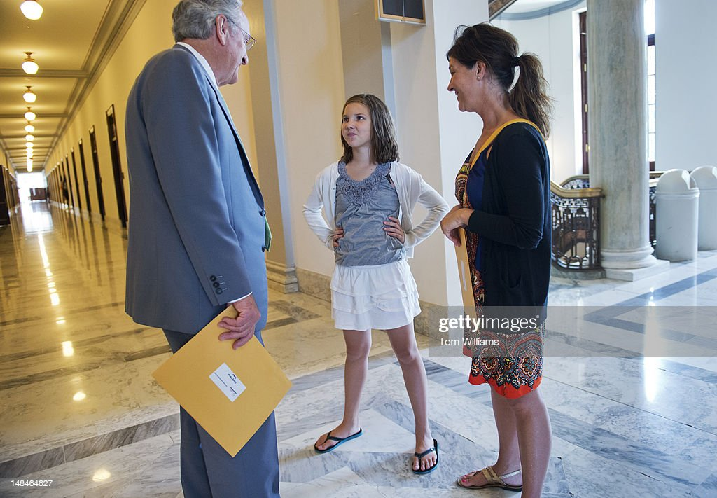 Sen. Tom Harkin, D-Iowa, talks with Carly, Loew, 11, and her mother Michelle, of Carroll, Iowa, in Russell Building. The younger Loew was the Iowa winner of the Tars Wars poster contest, an anti-smoking campaign.