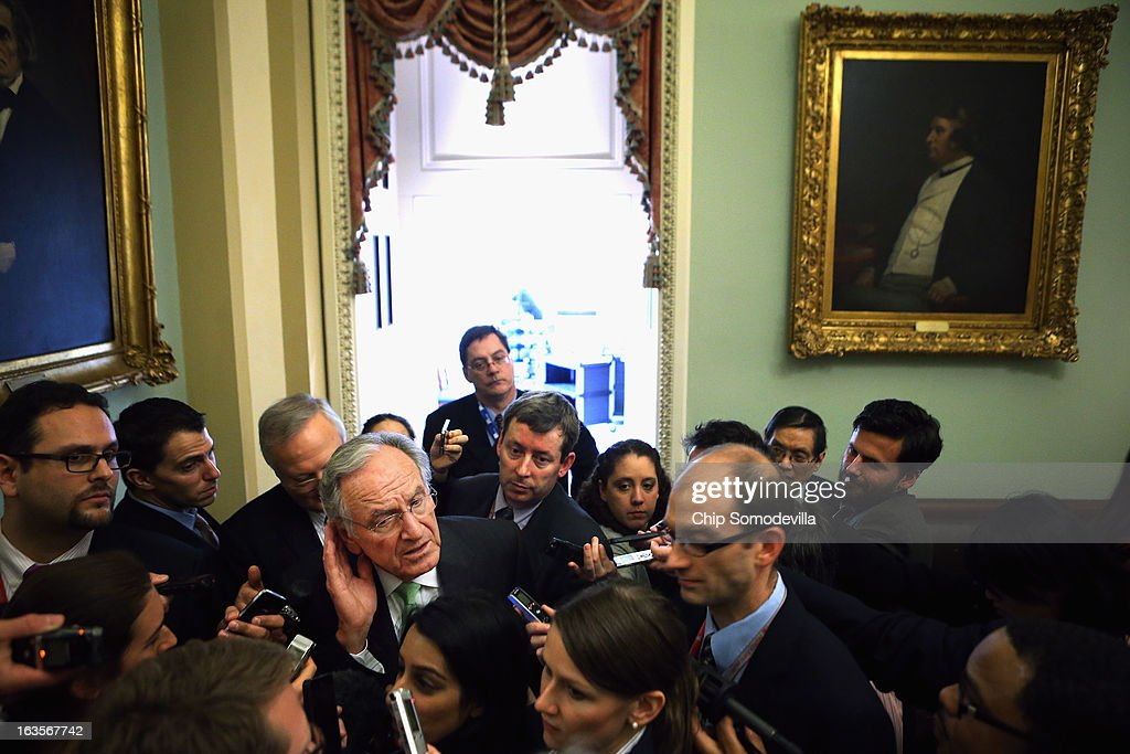 Sen. Tom Harkin (D-IA) (C) listens to reporters' questions after he and fellow Senate Democrats met with U.S. President Barack Obama in the Mansfield Room at the U.S. Capitol March 12, 2013 in Washington, DC. With tax reform, spending cuts, gun control and immigration on the agenda, Obama will be holding four meetings over three days this week with Republican and Democratic members of Congress at the U.S. Capitol.
