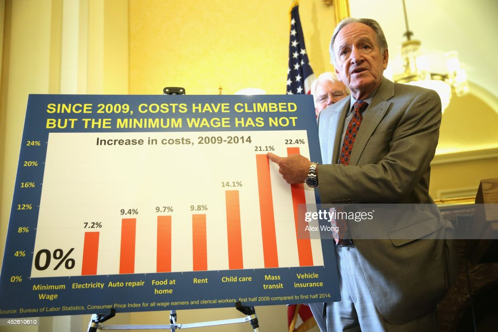 U.S. Sen. <a gi-track='captionPersonalityLinkClicked' href=/galleries/search?phrase=Tom+Harkin&family=editorial&specificpeople=211373 ng-click='$event.stopPropagation()'>Tom Harkin</a> (D-IA) (R) points to a chart as Rep. <a gi-track='captionPersonalityLinkClicked' href=/galleries/search?phrase=George+Miller+-+Politiker&family=editorial&specificpeople=13488521 ng-click='$event.stopPropagation()'>George Miller</a> (D-CA) (L) looks on during a news conference July 24, 2014 on Capitol Hill in Washington, DC. The news conference was to call on Congress to raise the national minimum wage.