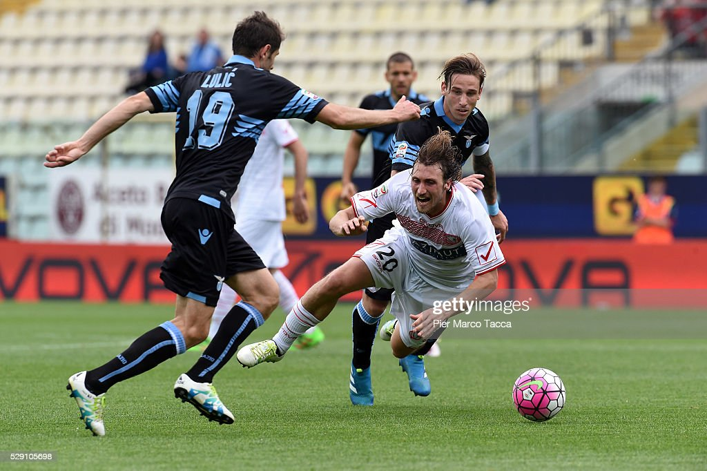 Senad Lulic and <a gi-track='captionPersonalityLinkClicked' href=/galleries/search?phrase=Lucas+Biglia&family=editorial&specificpeople=627651 ng-click='$event.stopPropagation()'>Lucas Biglia</a> of SS Lazio compete for the ball with Lorenzo Lollo of Carpi FC during the Serie A match between Carpi FC and SS Lazio at Alberto Braglia Stadium on May 8, 2016 in Modena, Italy.