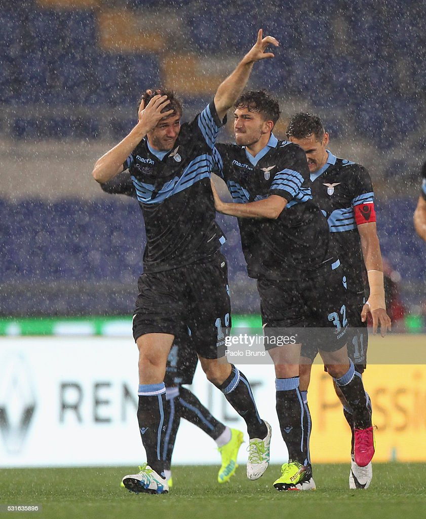 Senad Lulic (L) celebrates with his teammates of SS Lazio after scoring the opening goal during the Serie A match between SS Lazio and ACF Fiorentina at Stadio Olimpico on May 15, 2016 in Rome, Italy.