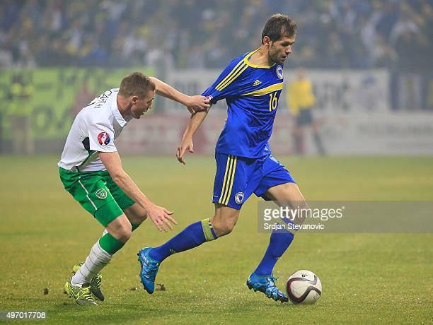 HERZEGOVINA NOVEMBER 13 Senad Lulic of Bosnia is challenged by James McCarthy of Ireland the EURO 2016 Qualifier PlayOff First Leg match at Bilino...