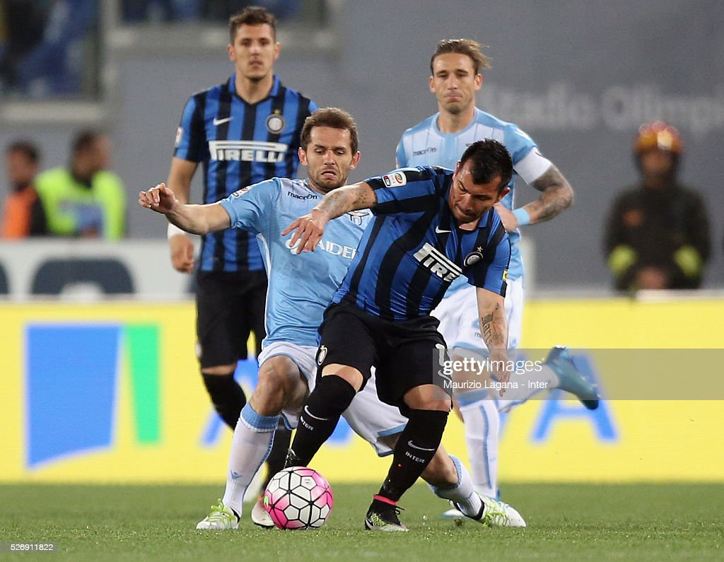 Senad Lulic (L) of Lazio competes for the ball with <a gi-track='captionPersonalityLinkClicked' href=/galleries/search?phrase=Gary+Medel&family=editorial&specificpeople=4123504 ng-click='$event.stopPropagation()'>Gary Medel</a> of Inter during the Serie A match between SS Lazio and FC Internazionale Milano at Stadio Olimpico on May 1, 2016 in Rome, Italy.
