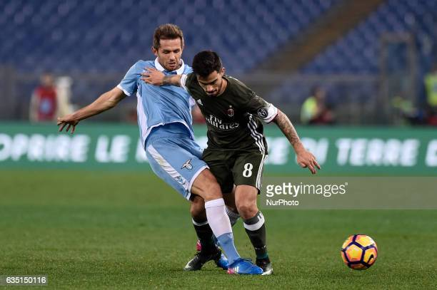 Senad Lulic of Lazio is challenged by Suso of AC Milan during the Serie A match between Lazio and Milan at Stadio Olimpico Rome Italy on 13 February...