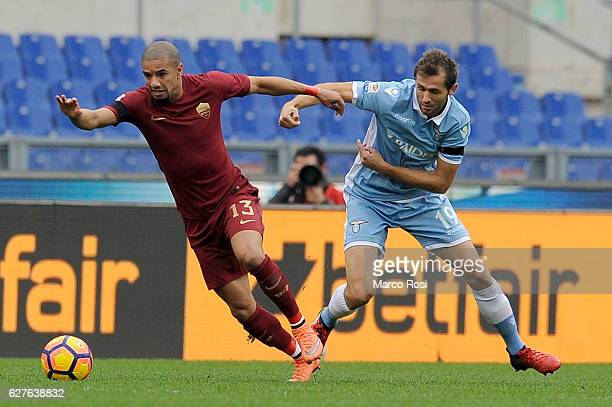 Senad Lulic of SS Lazio compete for the ball with Bruno Peres of AS Roma during the Serie A match between SS Lazio and AS Roma at Stadio Olimpico on...