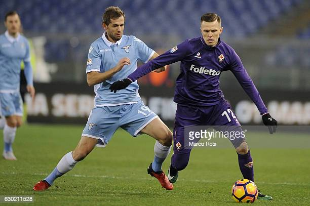Senad Lulic of SS Lazio compete for the ball with Josip Ilicic ACF Fiorentina during the Serie A match between SS Lazio and ACF Fiorentina at Stadio...