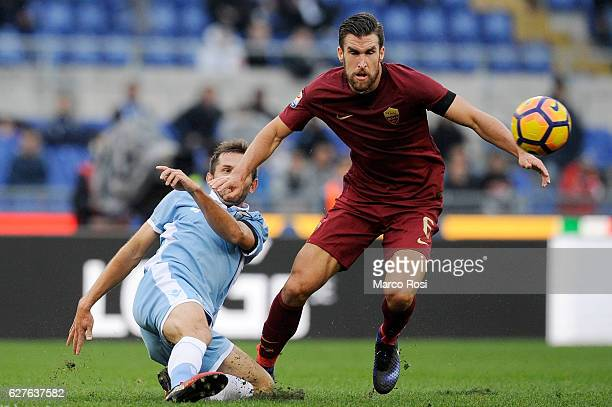 Senad Lulic of SS Lazio compete for the ball with Kevis Strootman of AS Roma during the Serie A match between SS Lazio and AS Roma at Stadio Olimpico...