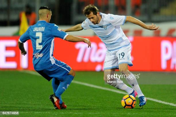 Senad Lulic of SS Lazio compete for the ball with Vincent Laurini of Empoli FC during the Serie A match between Empoli FC and SS Lazio at Stadio...