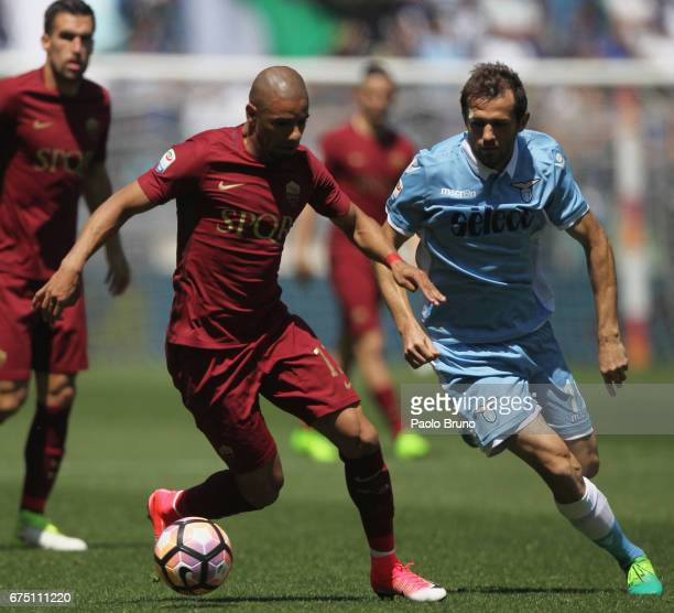 Senad Lulic of SS Lazio competes for the ball with Bruno Peres of AS Roma during the Serie A match between AS Roma and SS Lazio at Stadio Olimpico on...