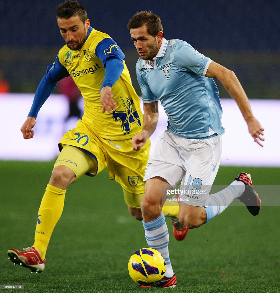 Senad Lulic(R) of S.S. Lazio competes for the ball with Gennaro Sardo of AC Chievo during the Serie A match between S.S. Lazio and AC Chievo Verona at Stadio Olimpico on January 26, 2013 in Rome, Italy.