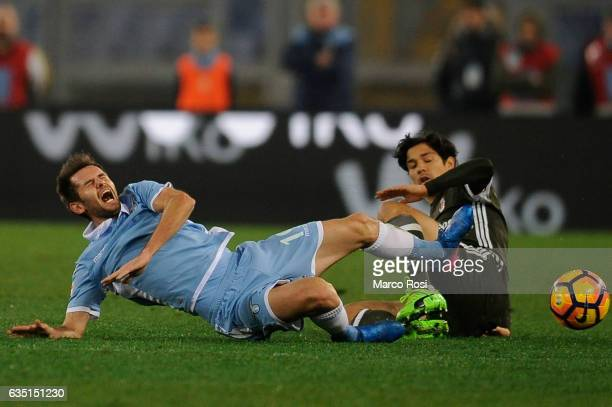 Senad Lulic of SS Lazio competes for the ball with Mati Fernandez of AC Milan during the Serie A match between SS Lazio and AC Milan at Stadio...