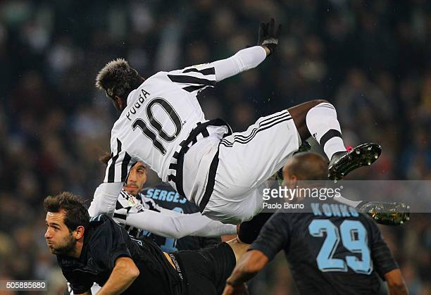 Senad Lulic of SS Lazio competes for the ball with Paul Pogba of Juventus FC during the TIM Cup match between SS Lazio and Juventus FC at Stadio...