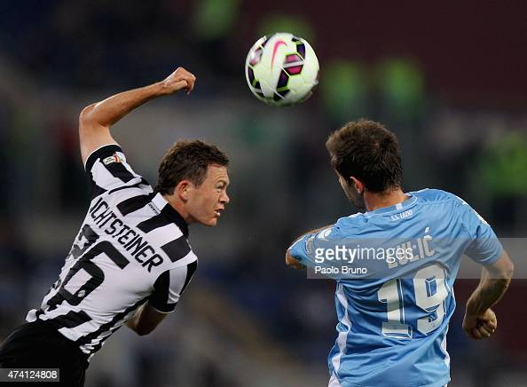 Senad Lulic of SS Lazio competes for the ball with Stephan Lichtsteiner of Juventus FC during the TIM Cup final match at Olimpico Stadium on May 20...