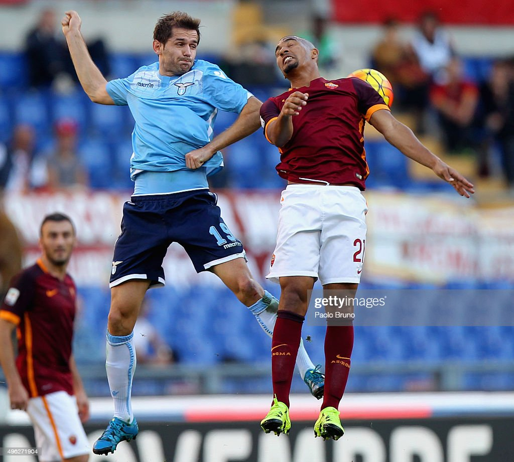 Senad Lulic (L) of SS Lazio competes for the ball with William Vainqueur of AS Roma during the Serie A match between AS Roma and SS Lazio at Stadio Olimpico on November 8, 2015 in Rome, Italy.