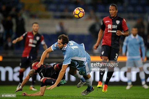 Senad Lulic of SS Lazio competes with Bruno Alves of Cagliari Calcio during the Serie A match between SS Lazio and Cagliari Calcio at Stadio Olimpico...