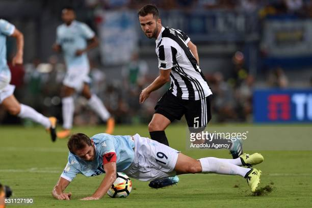 Senad Lulic of SS Lazio in action against Miralem Pjanic of FC Juventus during the Italian Super Cup soccer match between FC Juventus and SS Lazio at...