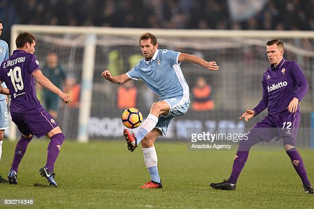 Senad Lulic of SS Lazio in action against Sebastian Cristoforo Josip Ilicic of ACF Fiorentina during the Serie A soccer match between SS Lazio and...