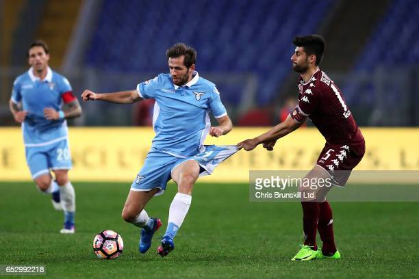 Senad Lulic of SS Lazio is fouled by Marco Bernassi of FC Torino during the Serie A match between SS Lazio and FC Torino at Stadio Olimpico on March...