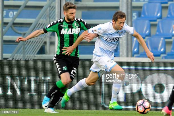 Senad Lulic of SS Lazio ompete for the ball with Domenico Berardi of US Sassuolo during the Serie A match between US Sassuolo and SS Lazio at Mapei...