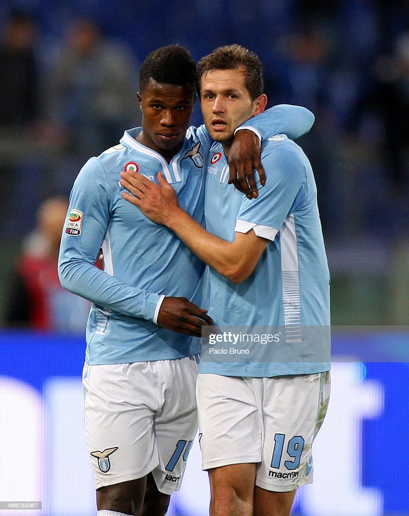 Senad Lulic (R) with his teammate Balde Diao Keita of SS Lazio celebrates after scoring the second team's goal during the Serie A match between SS Lazio and Hellas Verona FC at Stadio Olimpico on May 5, 2014 in Rome, Italy.