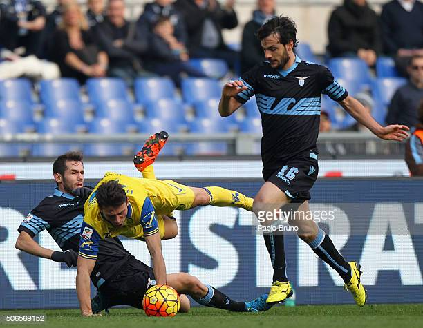 Senad Lulic with his teammate Marco Parolo of SS Lazio compete for the ball with Roberto Inglese of AC Chievo Verona during the Serie A match between...