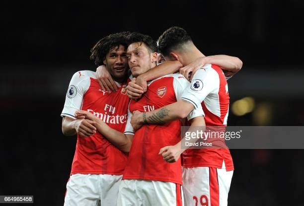 senal Mesut Ozil celebrates scoring a goal for Arsenal with Mohamed Elneny during the Premier League match between Arsenal and West Ham United at...